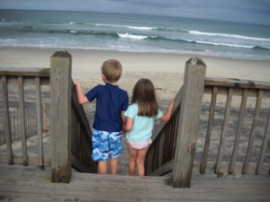 kids looking towards the beach