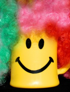 A happy face mug with a clown wig -- how can you NOT laugh?  Photo credit: Microsoft ClipArt Gallery