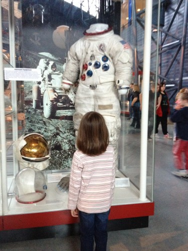 JavaGirl contemplates an astronaut suit
